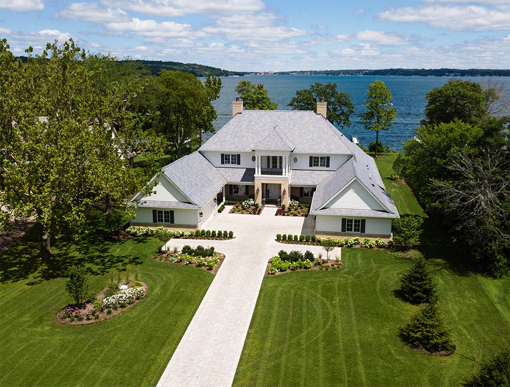 drone aerial view of house on lake